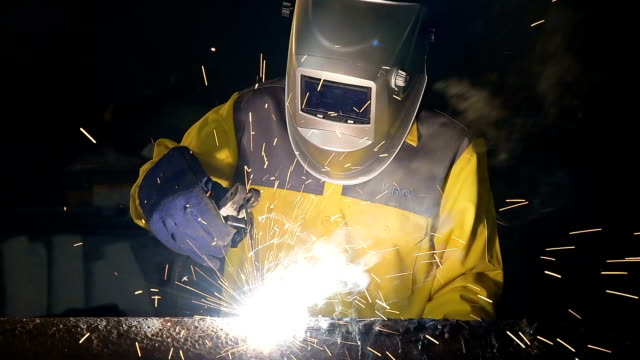 Worker welding the steel part video