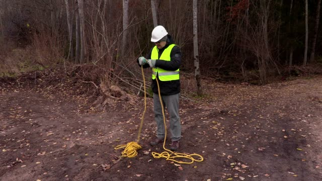 Worker with rope in forest video
