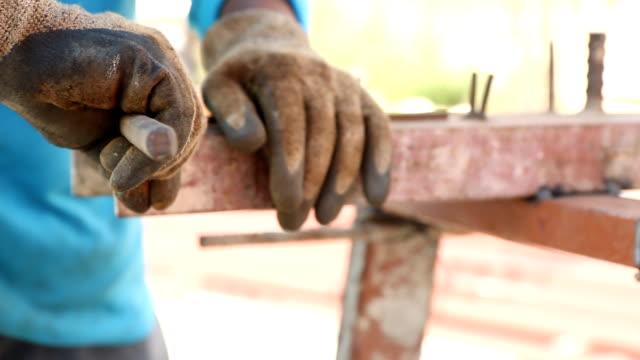 Workers are bending rebar. video