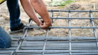 workers are  preparing steel poles for building house video