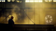 workers at the plant or factory processed metal. video