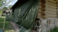 Workers covering the newly constructed cabin with big cloth FS700 Odyssey 7Q 4K video