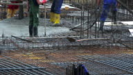 HD Workers directing concrete onto the construction site video