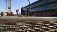 Workers Directing Concrete Onto The Construction Site video