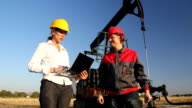 Workers in an Oilfield, teamwork video