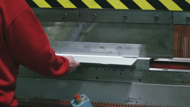 Workers in factory warehouse video