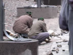Workers Laying Cobble Stones video
