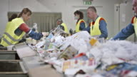 LD workers making last waste paper check on conveyor belt video