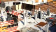 T/L Workers On Construction Site (Tilt Shift Effect) video