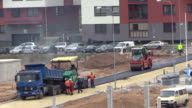 Workers pavers work with asphalt spreader and roller machines video