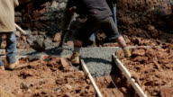 Workers Pour Cement at Joint video