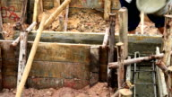 workers pouring cement foundation for house building video