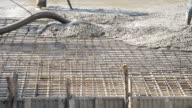 workers pouring concrete. video