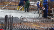HD Workers Smoothing Concrete on Construction Site video