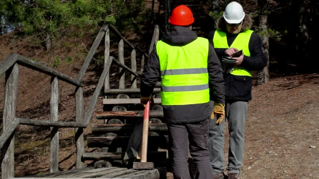 Workers talking near to the broken wooden track video