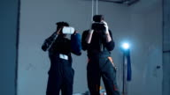 Workers using the VR goggles video
