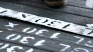 Workers writing id numbers on steel blocks video