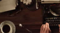 DS Working in an office on old typewriter video