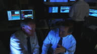 Working late into the evening in financial business video