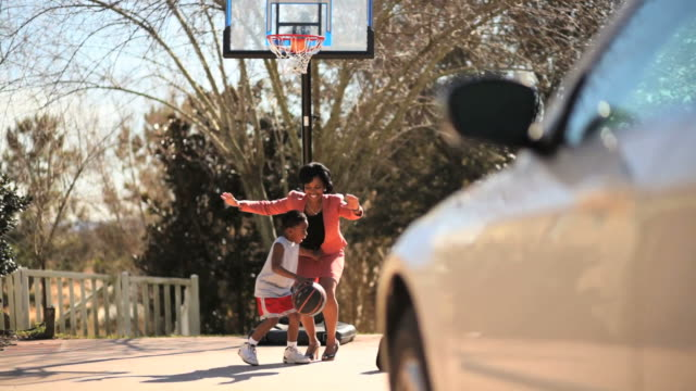 Working Mom Playing Basketball with Her Son video