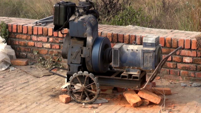 working old portable electricity generator in Nepal video
