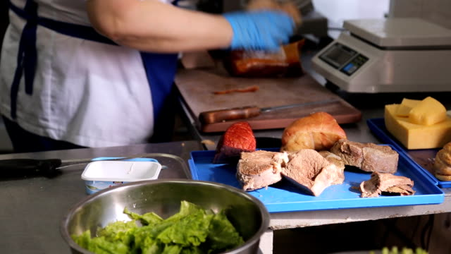 Working place of cook in an apron in kitchen, public canteen video