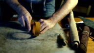 Working process of making leather belt in the leather workshop video