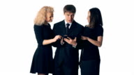 Working together. Three happy young people looking at digital tablet. Isolated over white background video