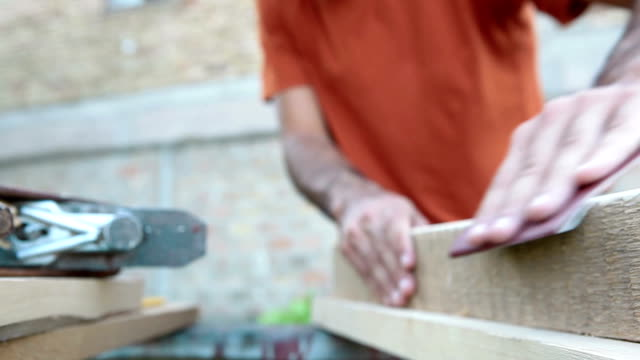 Working with sand paper on wooden board video