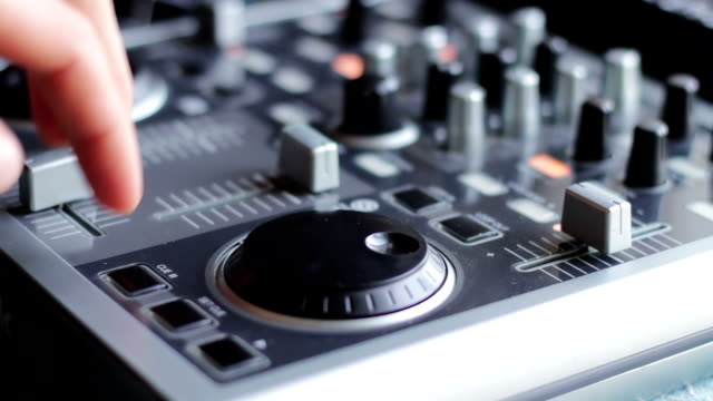 DJ Working with Sound mixing console video