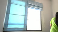 Working woman is installing DIY windows video