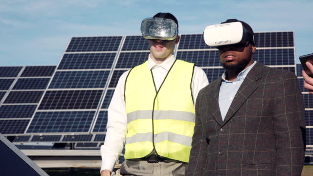 Workman and investor wear virtual reality glasses video