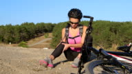 Workout fitness injuries woman cyclist with pain in knee joint video