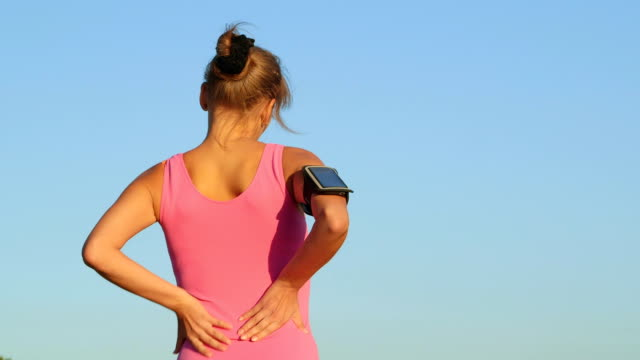 Workout fitness injuries  woman with lower back pain during exercise video