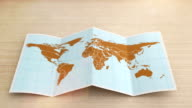 World map folds out on desk. Three in one. video
