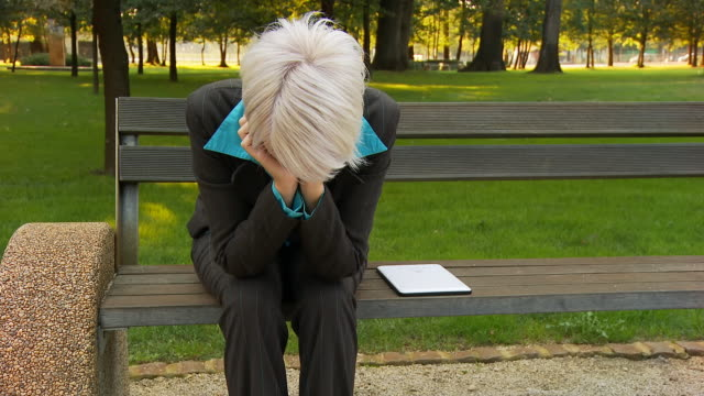 HD DOLLY: Worried Businesswoman In The Park video