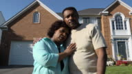 Worried Couple in Front of Home video