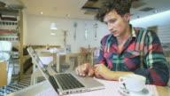 Worried man working on laptop. video