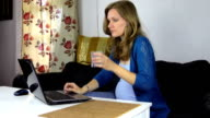 Worried pregnant business woman working near laptop drink water video