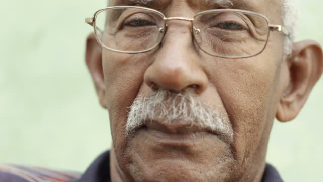 Worried senior african american man with eyeglasses video