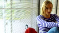 Worried student sitting by window video