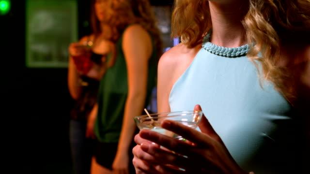 Worried woman having a drink video