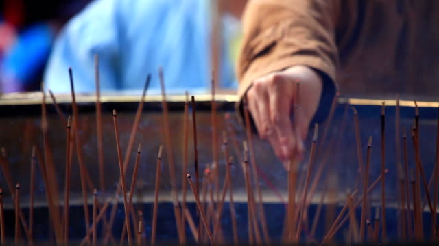 Worshiping gods or ancestors by burning incense video