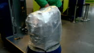 Wrapping luggage baggage bag at airport terminal video