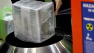wrapping service at airport video
