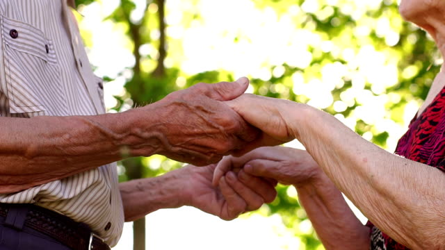 Wrinkled hands of an elderly couple, close-up. video