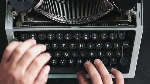 Writer typing with retro writing machine. video