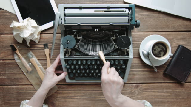 Writer with retro writing machine. video