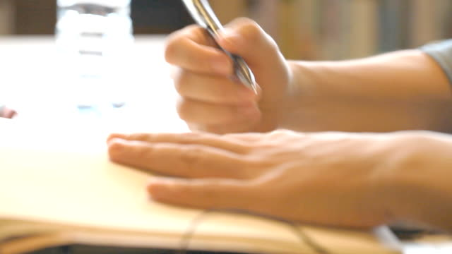 Writing on notebook video