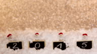 2015 written on christmas slates in the snow  on defocused background video